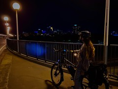 A nighttime photo of Lauren with a bike